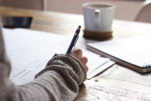 Writer writing showing writing skills