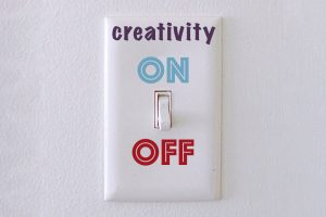 Switch on a watch labelled creativity with an on and off switch