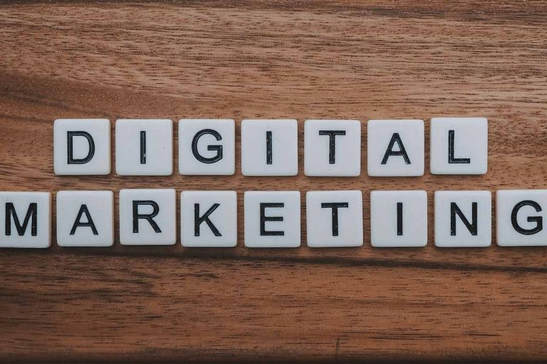 Scrabble tiles spelling out Digital Marketing laid out on a wooden table