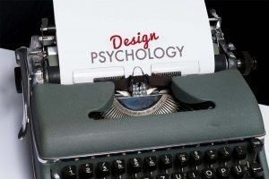 Old fashioned typewriter with the words design psychology on a white piece of paper